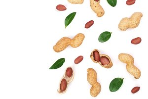 Peanuts with shells isolated on white background with copy space for your text, top view. Flat lay pattern