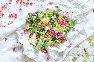 Healthy vegetarian salad on wooden
