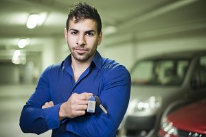 Man posing in garage