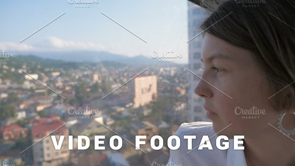Young Girl Look Through The Window From Cabin In Rope Way Batumi Georgia