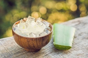 Aloe vera and aloe cubes in a wooden bowl. Aloe Vera gel almost use in food, medicine and beauty industry