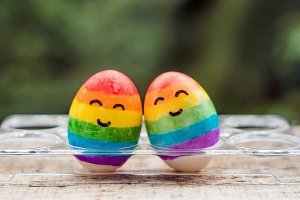 Two eggs are colored in the colors of the rainbow as a flag of gays and lesbians as well as Easter eggs. Homosexual concept