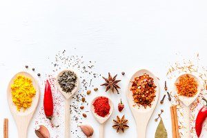 spoons with condiments and spices