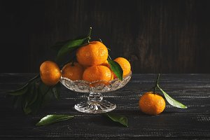 Tangerines on a dark background. Toned photo. Selective focus.