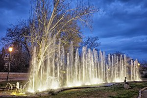 Lit garden fountain