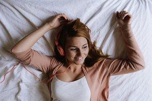 Beautiful woman listening music.