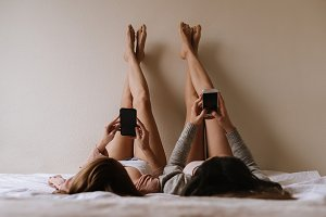 Gorgeous friends using her mobiles.