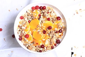 Breakfast granola with cranberries banana and mango mousse