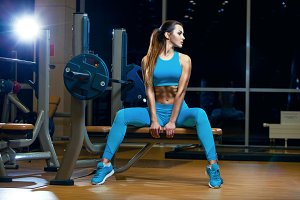 sexy young girl resting after exercises. Fitness brunette woman