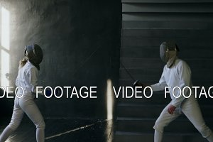 Slowmotion of Two fencers man and woman have fencing training indoors