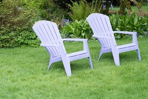 Lawn chairs with green lawn