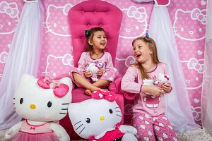 two girls in pajamas on photo shoot