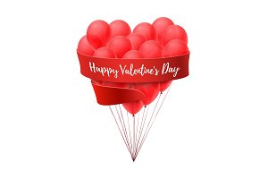 Ballons in form of heart with red ribbon.