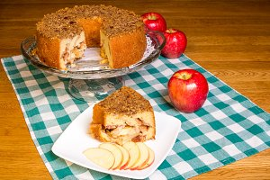 Apple cake with slice on plate