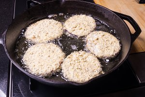 Cast iron skillet frying eggplant