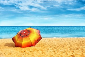 Umbrella on golden sand beach