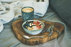 Rice coconut porridge and espresso in bed, copy space