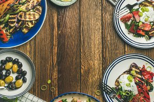 Flat-lay of healthy vegetarian dinner table setting, square crop
