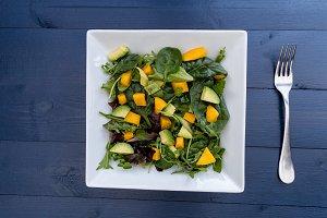 Mango avocado salad on plate