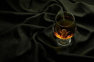 Brandy on black cloth