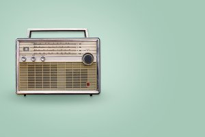 Vintage radio on color background