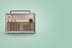 Vintage radio on color background