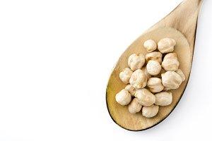 Chickpeas on wooden spoon
