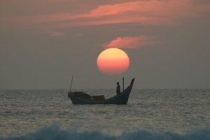 Fisherman behind the sun