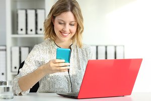 Happy businesswoman using technology
