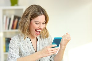 Excited woman reading online content