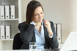 Businesswoman suffering neck ache