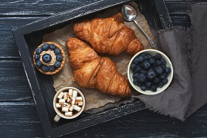 Croissants, cake with blueberries