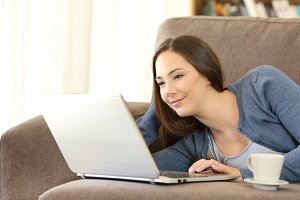 Relaxed woman using a laptop