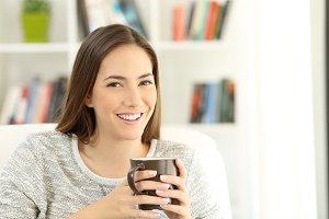 Happy woman holding a coffee mug