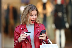 Surprised shopper wearing red jacket