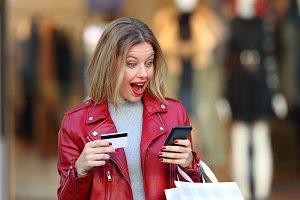 Surprised shopper wearing red jacket
