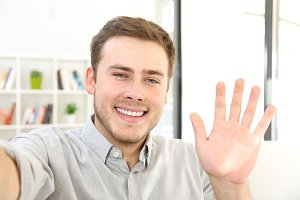 Man waving on a video call
