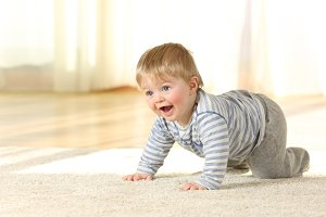Happy baby crawling and laughing