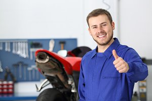 portrait of a motorbike mechanic