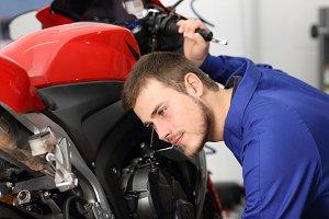 Motorcycle mechanic listening noises