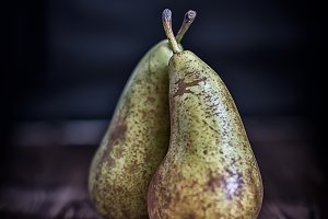 couple pears on wooden background