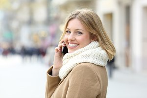 Happy lady calling on mobile phone