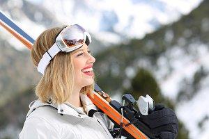 Side view portrait of a happy skier