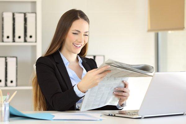 Happy executive reading