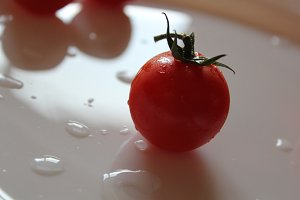 The picture of one cherry tomato