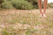 Female legs walking on the grass