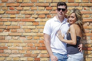 Couple portrait in front of wall