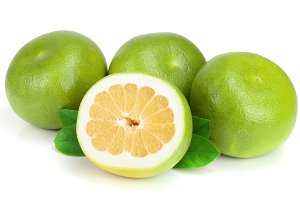 Citrus Sweetie or Pomelit, oroblanco with half and leaf isolated on white background close-up