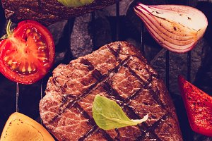 Steak on a barbecue grill