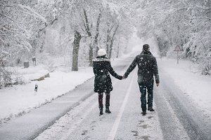 wedding couple walking in the snow